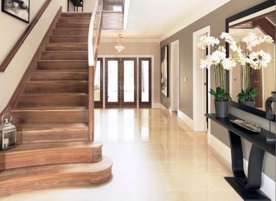 curved walnut staircase with glass