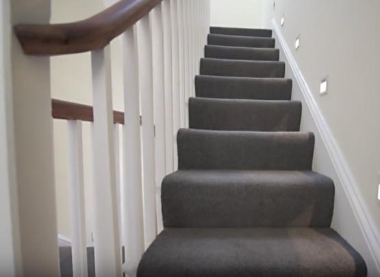 staircase, cut string, grey carpet