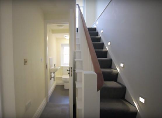 staircase, cut string, grey carpet,