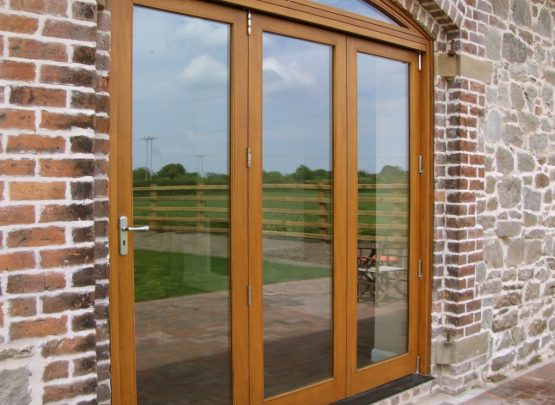 bi fold doors with curved head in barn