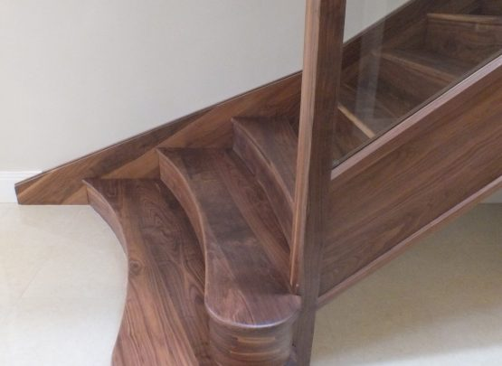 curved walnut staircase bottom steps