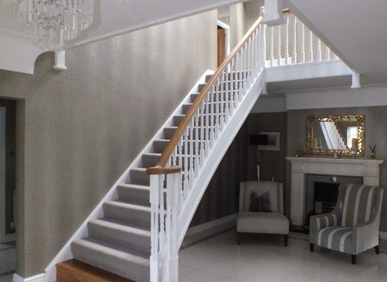 white staircase, oak handrail and bottom step