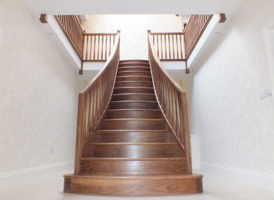 twin curved staircase, curved treads, modern spindles