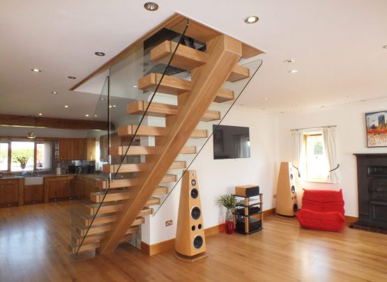open plan, central spine staircase, free standing glass