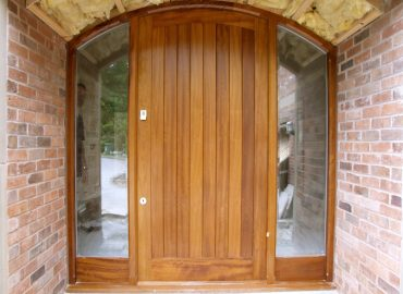 curved hardwood door and frame