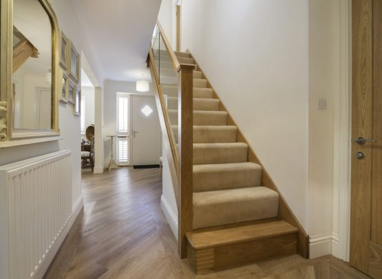 Oak Staircase in hallway, carpeted steps