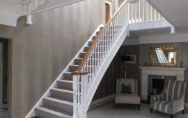 white staircase, oak handrail and bottom step