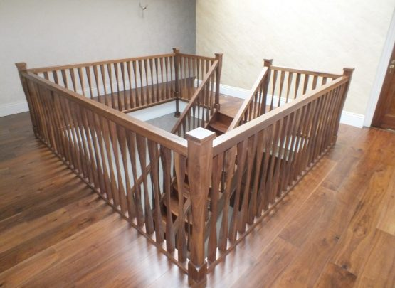 twin curved walnut staircase, curved treads, modern spindles