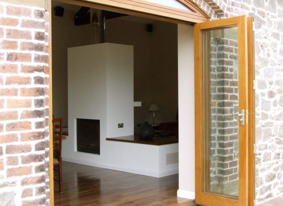 external timber bi fold doors, with curved head