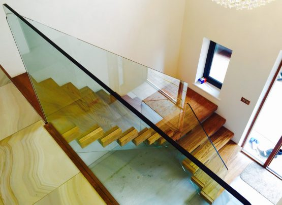central spine glass staircase