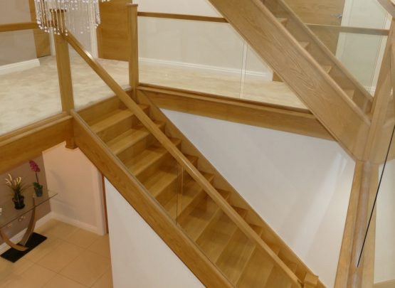 oak staircase with glass loft staircase