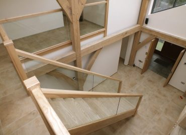open plan glass staircase in barn conversion